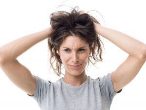 Angry woman with hands in her hair realizing she has lice, Amy Geist freelance writer