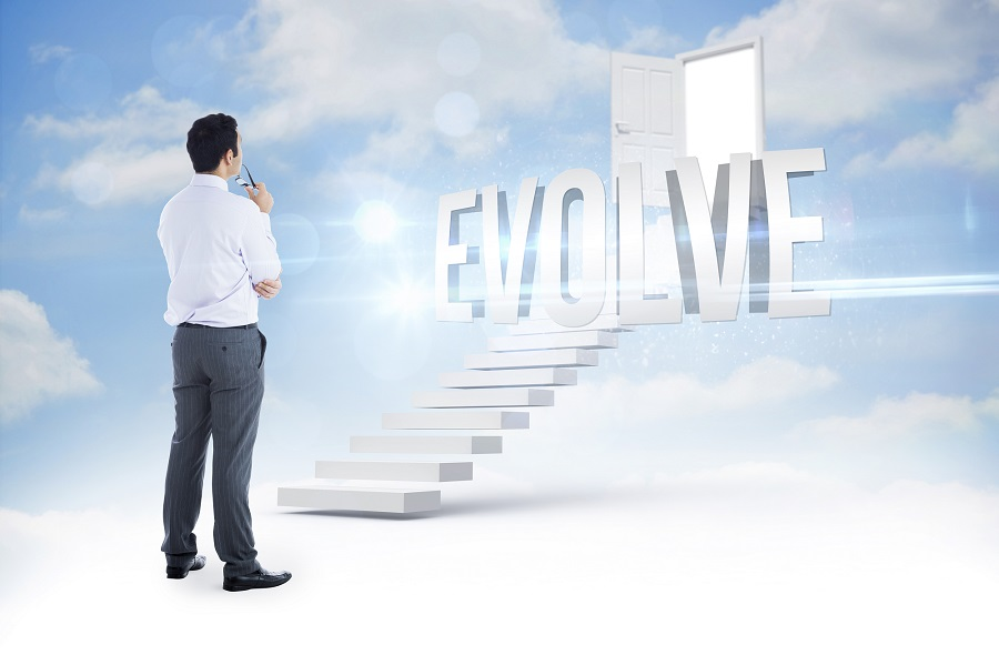 businessman looking at a white staircase ascending into the sky with the word Evolve at the top