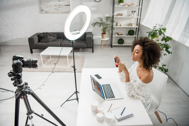 female social media influencer preparing to shoot a marketing video