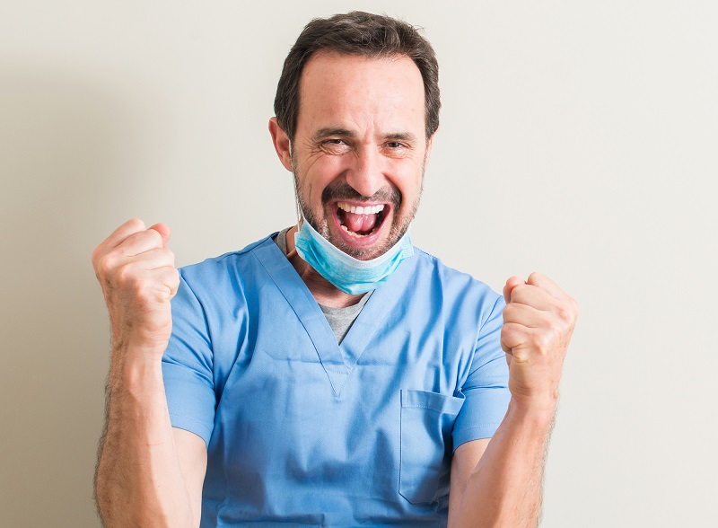 surgeon celebrating after a successful bunion surgery